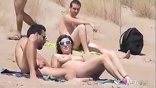 That babe copulates a bloke almost a seaside replete voyeurs
